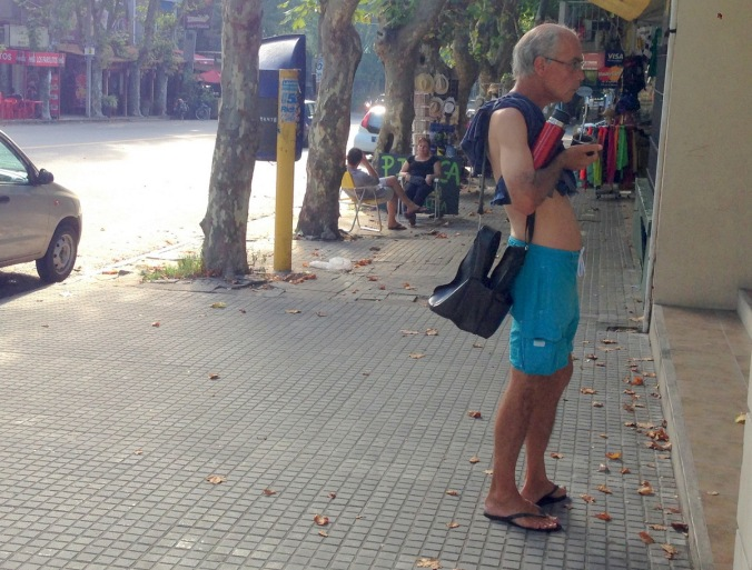 This man is carrying his thermos of water, which he uses to refill his mate cup. Apparently, this drink also keeps you thin.