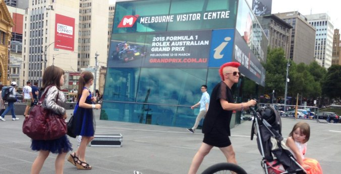This sums up Melbourne perfectly - a woman with a red Mohawk pushes a stroller with a child in a princess dress.