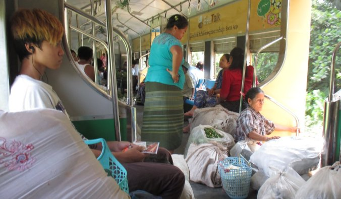 Passengers on the Yangon Circular Railway loaded down with goods from the vegetable market.