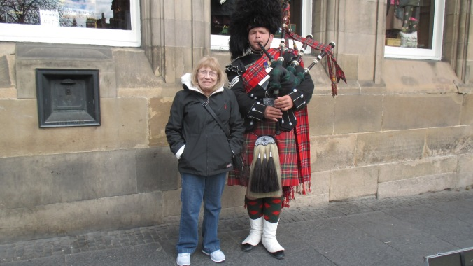 My mother enjoying the company of a Scottish highlander.